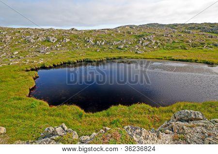 Small Tarn On A Remote Hillside