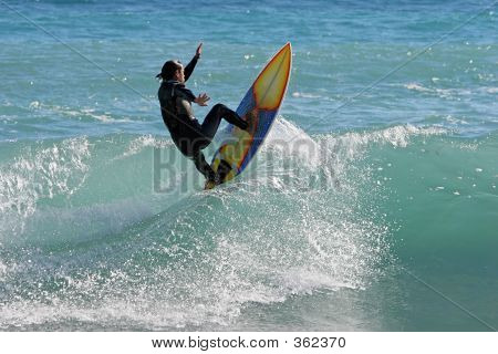 Good Excellent Experienced Surfer Carving Or Catching A Big Wave