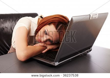 Woman Sleeping On Her Computer