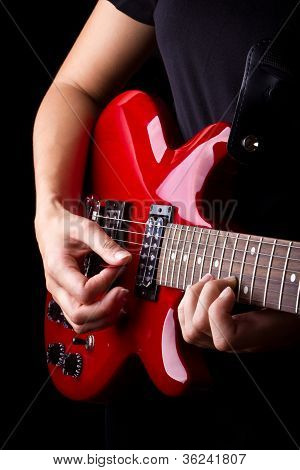 Closeup View Of Playing Electric Red Guitar