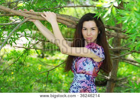 Beautiful Girl In A Summer Garden
