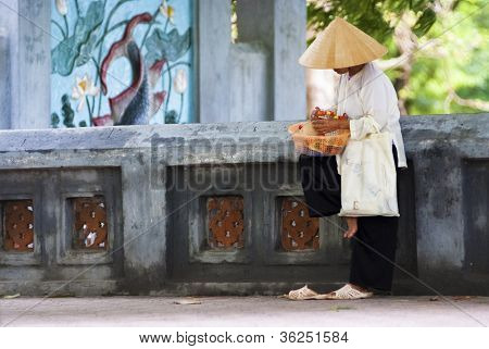 Street Vendor In Hanoi