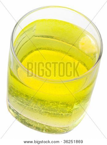Glass Of Yellow Carbonated Water With Vitamin C