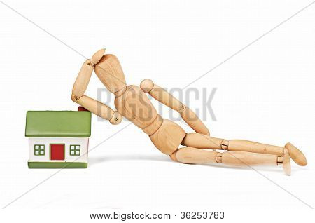 Doll and home isolated on white background