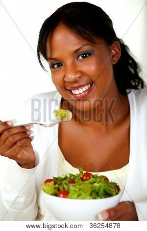 Gorgeous Young Woman Eating Vegetable Salad