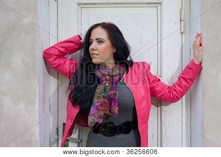 A Girl Standing In Front Of The Closed Door.