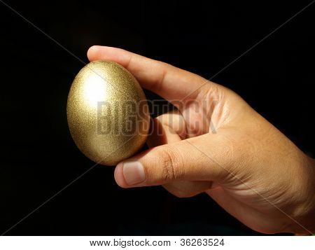 hand holding the golden egg