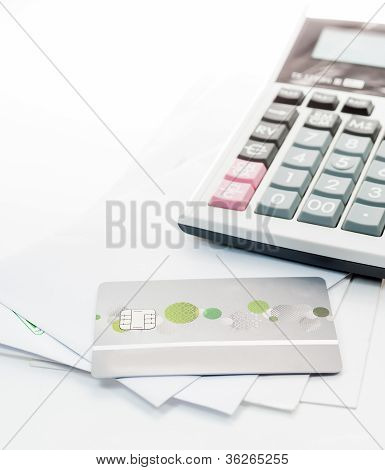 Credit Card And Calculator On White Envelope Isolate