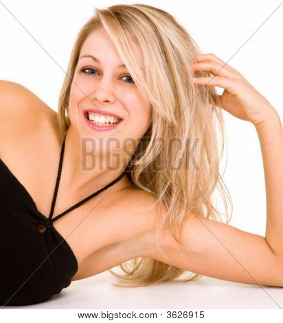 Beautiful Smiling Blonde Lying Down And Relaxing