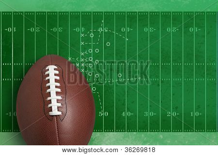 Football in front of diagram of football field