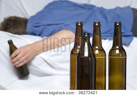 Man Passed Out With A Beer Bottle In His Hand