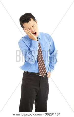 young businessman in agony with a toothache over white background