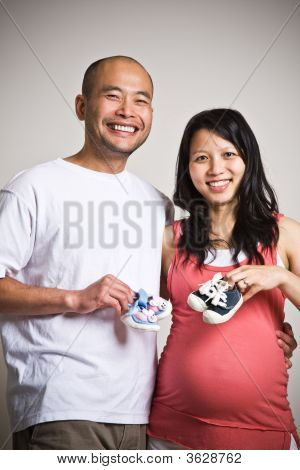 Happy Expecting Asian Couple