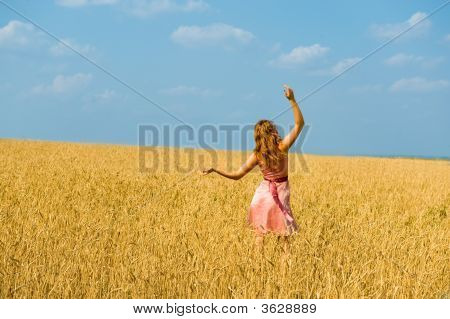 Young Girl Walks On A Field