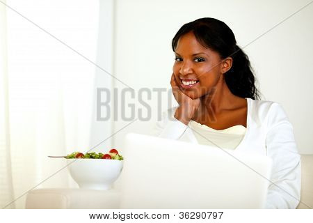 Charming Black Woman Looking And Smiling At You