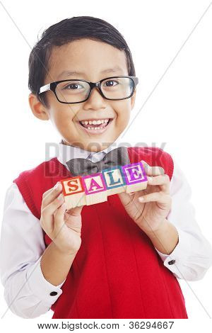Smart Asian Boy With A Sale Sign