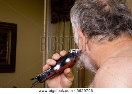 Older Man Cleaning Up His Beard