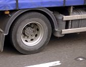 pic of friction  - A truck wheel turning at high speed on a roadway - JPG