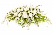 stock photo of casket  - Silk casket cover funeral flower arrangement with lilies - JPG