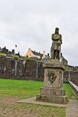 stock photo of william wallace  - A statue of William Wallace in front of Stirling Castle in Scotland - JPG