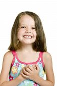 stock photo of tooth gap  - little girl with crooked teeth isolated over white - JPG
