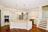 stock photo of wainscoting  - luxury modern kitchen with island granite counters and wood floors - JPG