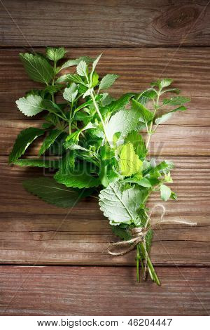 Fresh Mint Bunch On Rustic Table