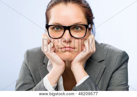 Tedious job woman bored at work in glasses