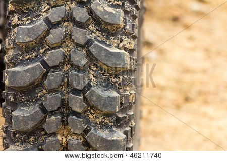 Tread Tire Coated In Mud
