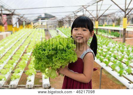 Child Holding Vegetable