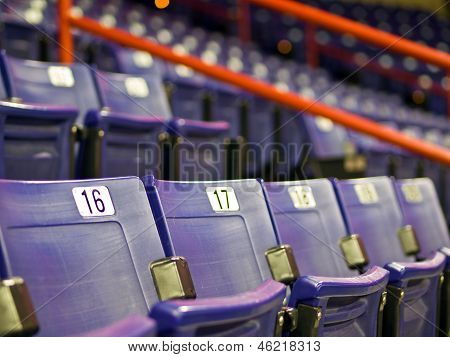 Blue Folding Seats At An Indoor Sports Arena