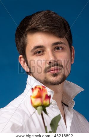 Man Giving The Red Roses. Close Up Portrait.