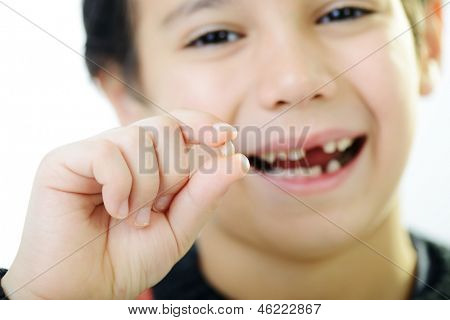 Portrait of cute kid losing his first tooth (Note: Selective focus)