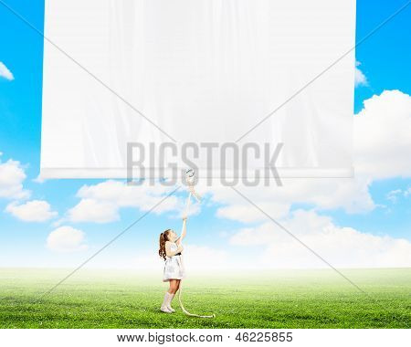 Little girl pulling banner