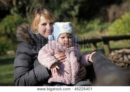 Baby girl with mother in the park