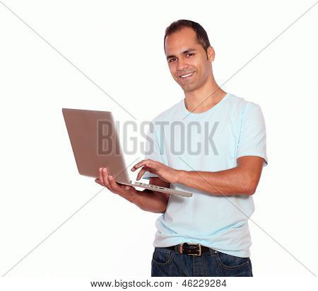 Smiling Latin Adult Man Using His Laptop Computer