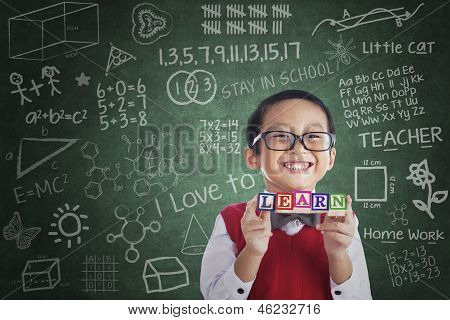 Asian Boy Student Hold Learn Block In Class