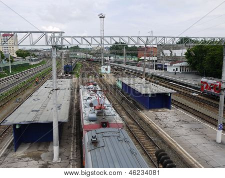 SARATOV, RUSSIA - MAY 2013. View of the railway in Saratov with a pedestrian overpass near the railw