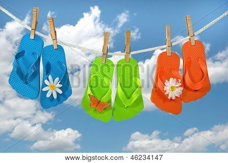 colorful flip-clops on clothesline