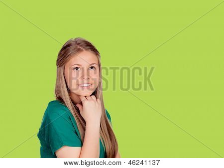 Indecisive girl looking up on green background