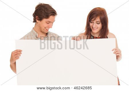 Caucasian couple with blank papers in their hands over white background