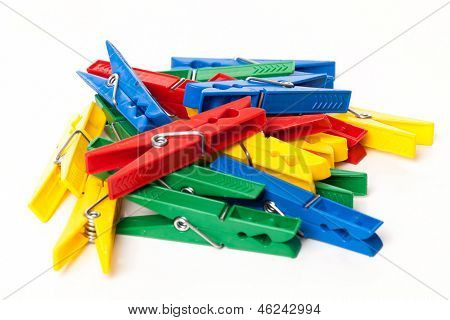 Closeup image of little colorful office clothespins isolated on a white background