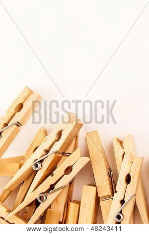 Closeup image of eco wooden clothespins on a white background