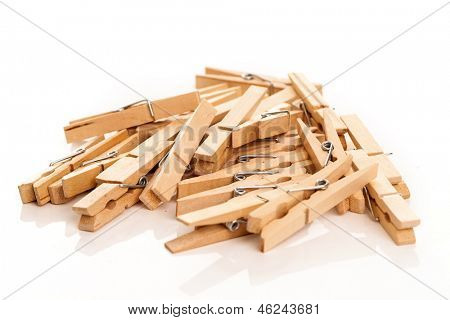 Closeup image of eco wooden clothespins isolated on a white background
