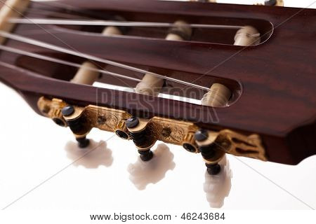 Closeup image of acoustic guitar fingerboard