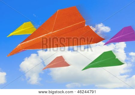 Paper Planes Against Sky With Clouds.