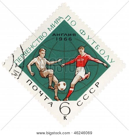 Soccer Player Kicks The Ball On Post Stamp