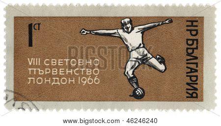 Football Player Kicks The Ball On Post Stamp