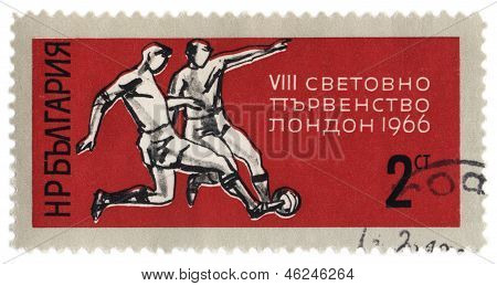 Two Players Fight For The Ball On Post Stamp