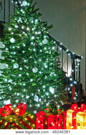 Extra bright christmas tree with presents